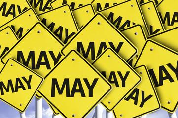 May yellow road sign