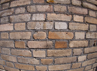 Old wall from gray and brown bricks