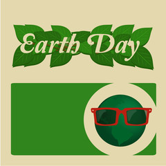 Earth Day, green leaves and planet with sunglasses