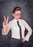 Beautiful fashion woman showing victory sign