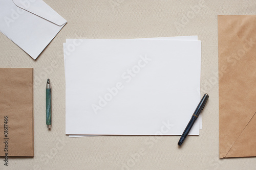 Empty envelopes and sheets of paper on the table - 81617466