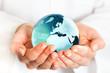 Hand holding blue earth globe