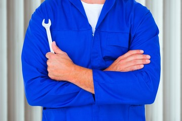 Image of male mechanic holding spanner