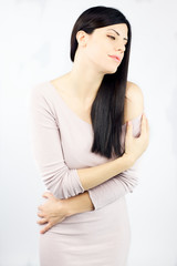 Woman with long black silky hair feeling beautiful