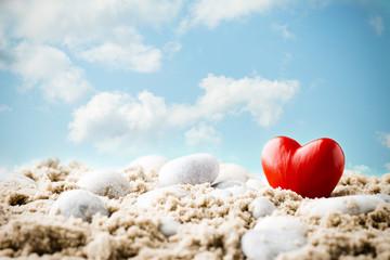 Heart on the sand on the seashore.