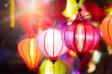 Traditional colorful silk lanterns at market street in Vietnam