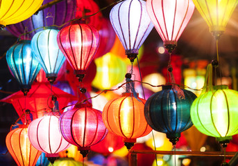 Traditional colorful silk lanterns at market street in Vietnam