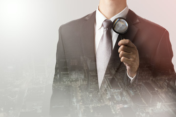 businessman using magnifying searching business