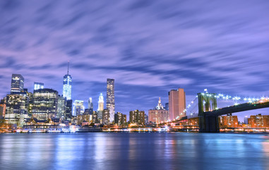 Manhattan skyline and Brooklyn Bridge at night.