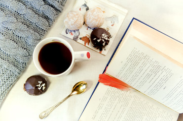 tea, cake, spoon and a book with a bookmark pen