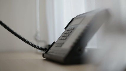 Phone in a hotel room or office. Close up