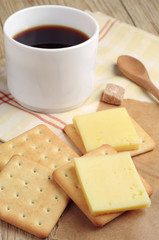 Cracker with cheese and coffee