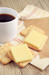 Coffee and cracker with cheese