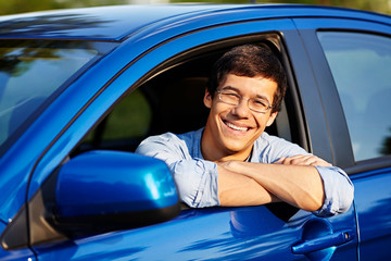 Guy looking out through open car window