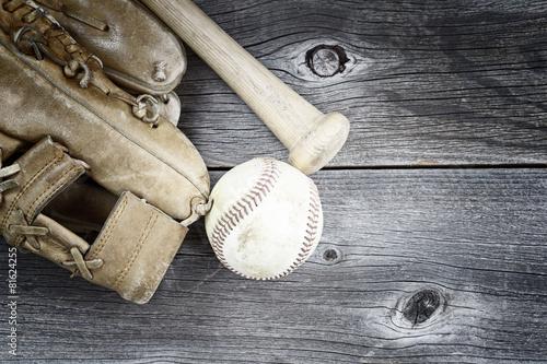 Used Baseball equipment on rustic wood - 81624255