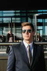 Elegant Businessman with Sunglasses in the Street