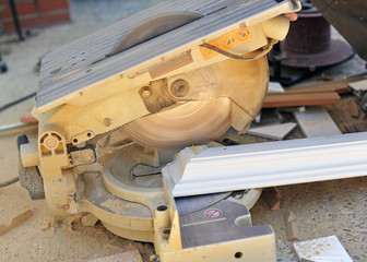 Carpenter cutting with miter saw