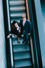 Business Couple in the Escalators