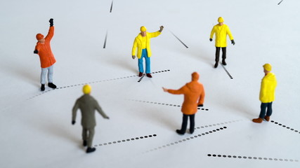 A group of workers network with each other and a bigger network.