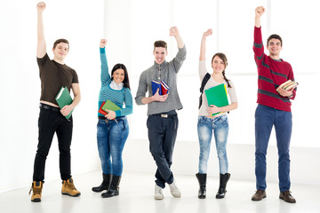 Group Of Successful Students With Books