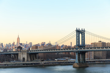 New York city sunset with focus on Manhattan Bridge