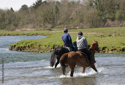 Poster Horse riders on the Ogmore River in South Wales UK