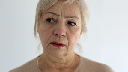 Senior portrait, elderly woman is sad and dissatisfied