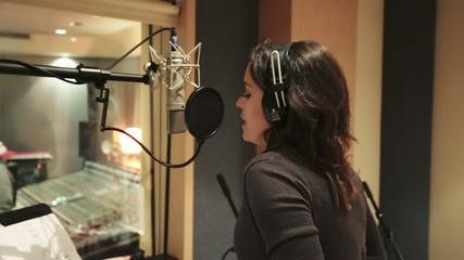Female singer recording Vocals at Studio