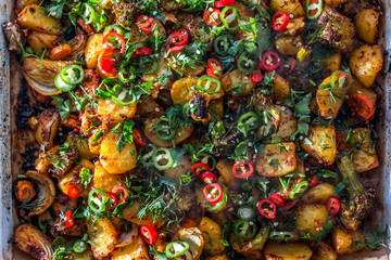 steamy baked potatoes with red and green chili pepper and fresh