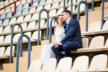 Beautiful couple sitting and watching football game stadium