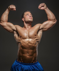 Male with naked torso posing in studio