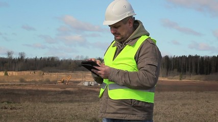 Engineer working with tablet PC on the field