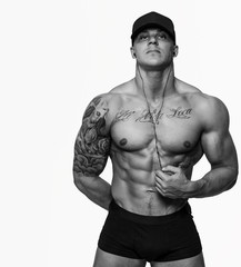 Awesome muscular guy in a cap