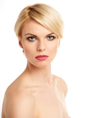 Beautiful face of young adult woman with clean fresh skin - isol