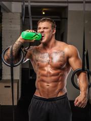 Tattoed bodybuilder on a rest