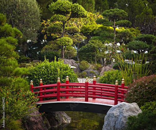 Fototapeta Red bridge in Japanese garden