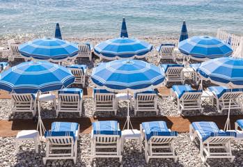 Blue beach umbrellas in Nice