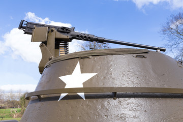 Machine gun on old american tank with blue sky