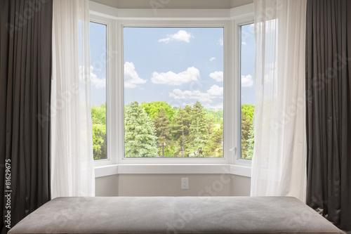 Leinwanddruck Bild Bay window with summer view