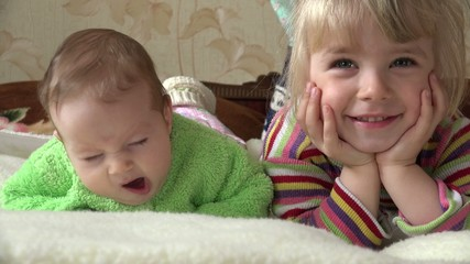 Little Girl and Newborn Baby, Two Sisters, Watching TV
