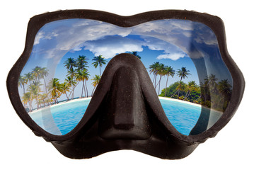 tropical landscape is reflected in mask glasses for snorkeling