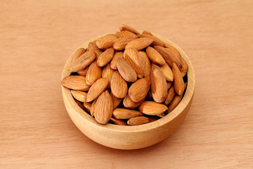 Fresh almonds in a wooden bowl