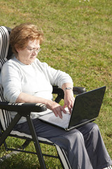 elderly woman with computer technology