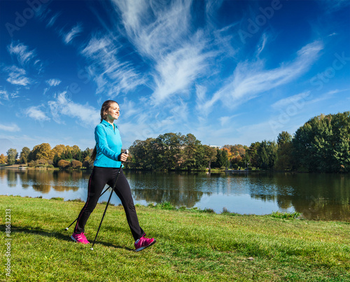 Young woman nordic walking - 81632213