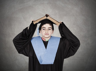 child with graduation gown