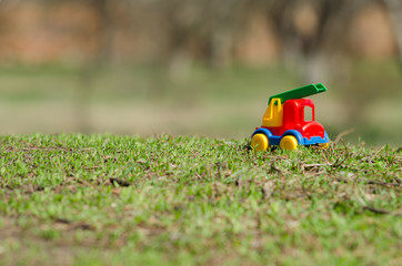 Plastic toy car on the grass, close-up