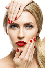 Girl with red lips and nails