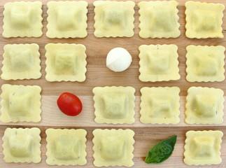 Checkerboard ravioli with tomato, bocconcini and basil