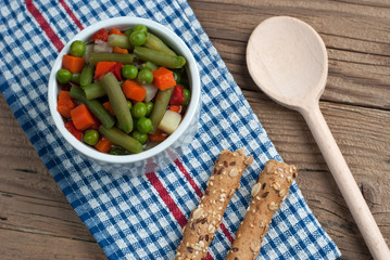 Vegetable soup on old wooden table