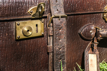 Old retro leather suitcase detail closeup
